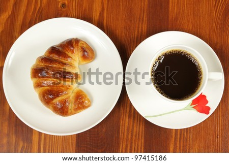 Black coffee and croissant. Breakfast top view - stock photo
