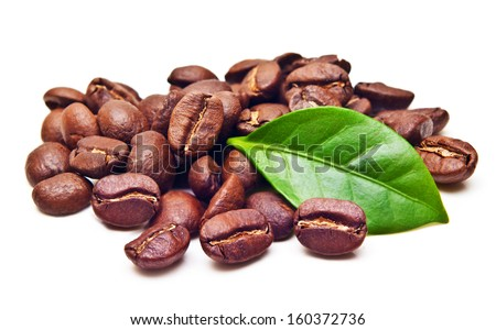 Black coffee beans, grain with leaf on white background. - stock photo