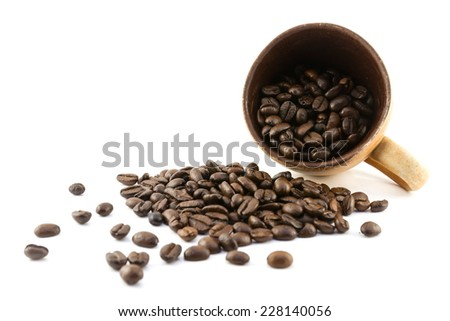 black coffee beans on white background - stock photo