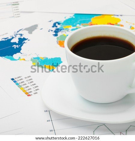 Black coffee cup over world map - 1 to 1 ratio - stock photo