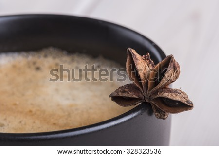 Black coffee cup with anise star - stock photo