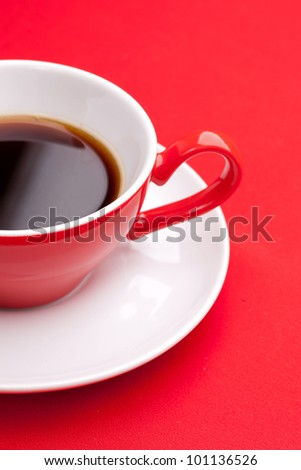 Black coffee in a porcelain dish of red - stock photo