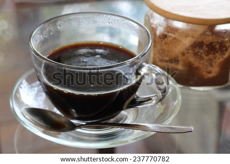 Black coffee in clear cup - stock photo