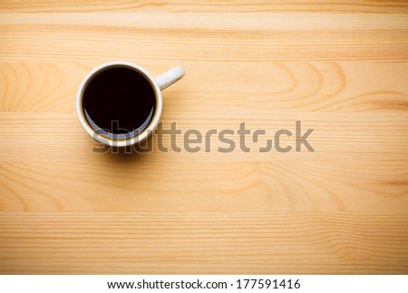 Black Coffee in White Ceramic Cup on Wooden Table - stock photo