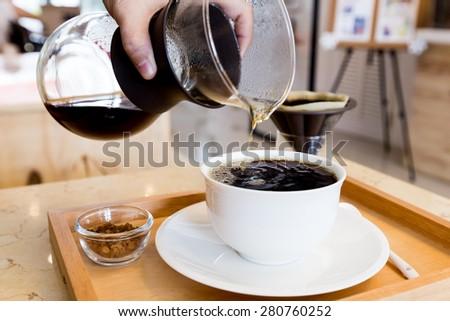 black coffee on white mug - stock photo