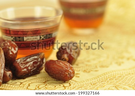 Black coffee with dates - a middle eastern refreshment drink - stock photo