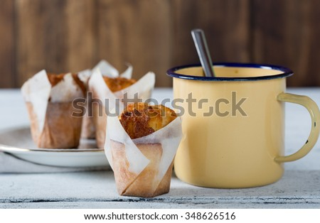 Black coffee with delicious homemade yogurt muffins - stock photo