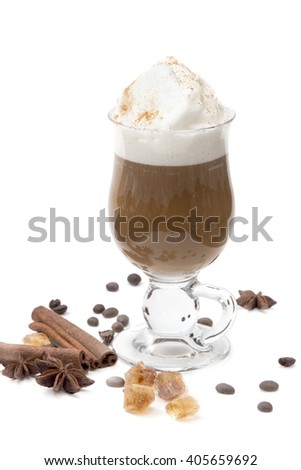 Black coffee with whipped cream in frappe glasses on a white background with cinnamon sticks, spices, coffee beans and caramel sugar. hot drink - latte, cappuccino.   - stock photo