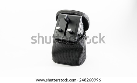 Black colour universal power plug adapter with dual usb port in a pouch for traveller in UK, Europe and USA or Australia. Isolated on white background.