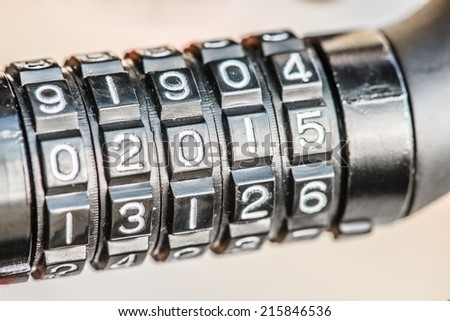 Black combination lock for bicycle, digit in 2015. - stock photo