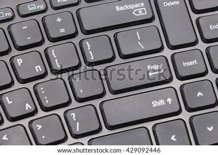 Black computer keyboard closeup background - stock photo