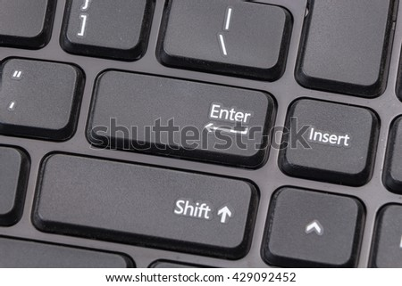 Black computer keyboard closeup on Enter - stock photo