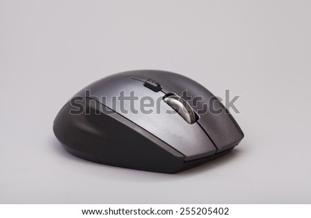 Black computer mouse on gray background