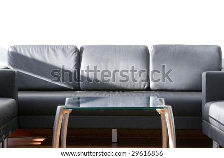 black couch and glass table - stock photo
