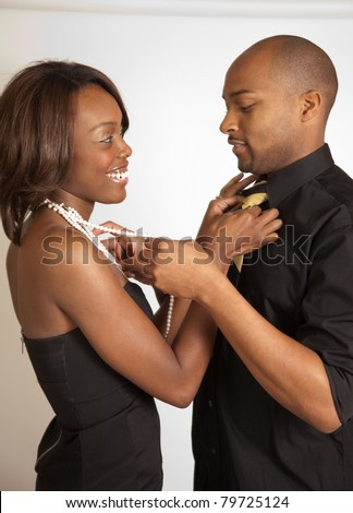 Black couple, arranging each others clothing before they go out