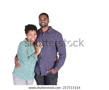 Black couple smiling and holding each other isolated on white - stock photo