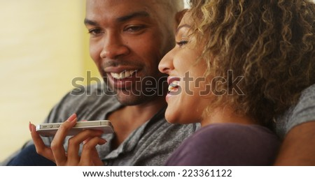 Black couple talking on smartphone - stock photo