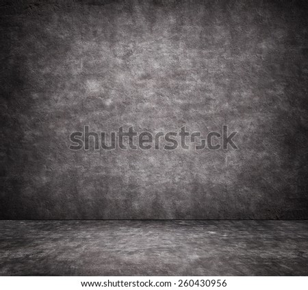 Black cracked concrete wall texture with sidewalk - stock photo