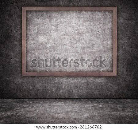Black cracked concrete wall texture with sidewalk and picture frame - stock photo