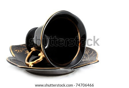 Black cup and saucer - stock photo