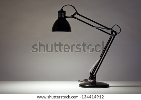 Black desk lamp isolated on white - stock photo
