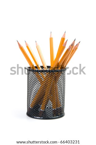 black desk organizer with pencils on a white background. - stock photo