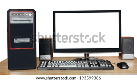 black desktop computer, widescreen display with cutout screen, keyboard, mouse, speakers on wooden table isolated on white background