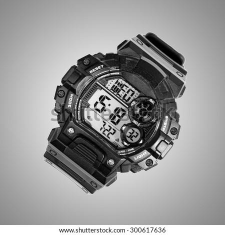 black digital watch on a gray background - stock photo