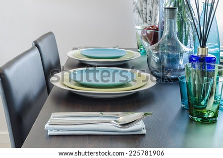 black dinner table with table set at home - stock photo