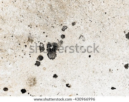 black dirty oil stain on concrete texture background