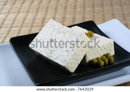 Black dish with tofu - stock photo