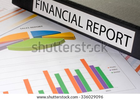 Black document binders with the label financial report - stock photo