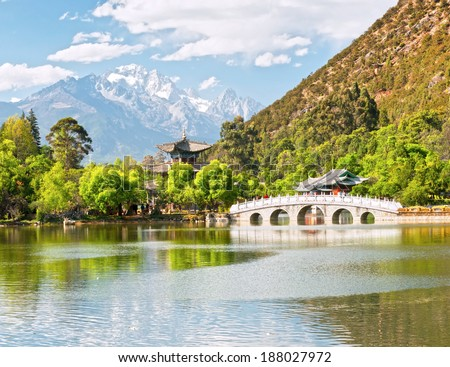 Black Dragon Pool. It's a famous pond in the scenic Jade Spring Park (Yu Quan Park) located at the foot of Elephant Hill, a short walk north of the Old Town of Lijiang in Yunnan province, China. - stock photo