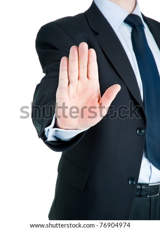 Black dressed businessman showing STOP - stock photo