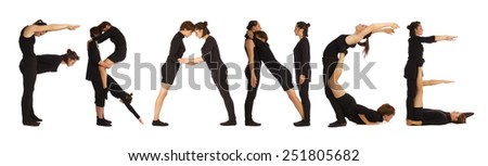 Black dressed people forming FRANCE word over white - stock photo