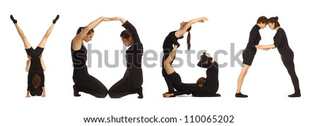 Black dressed people forming YOGA word over white - stock photo