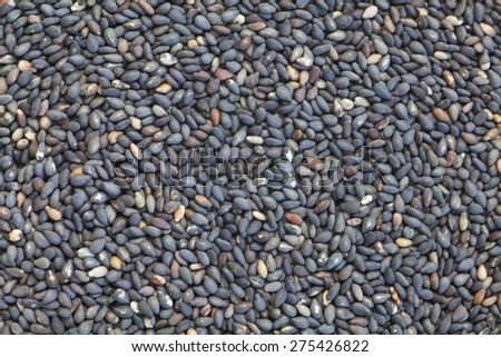 Black dry sesame seed , a common ingredient in cuisine - stock photo