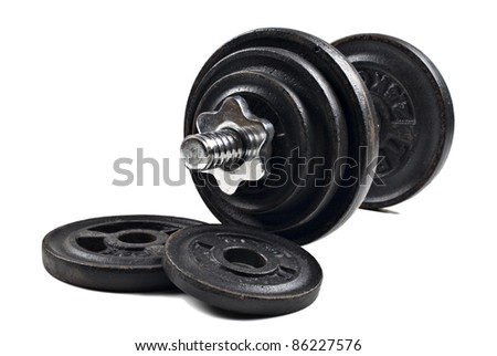 Black dumbbells and loose weights on a white background with space for text - stock photo