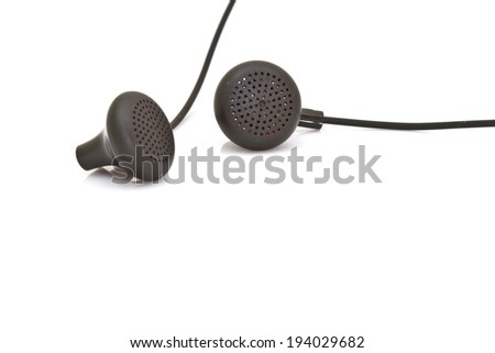 black earphones on a white isolated background