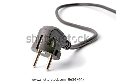 Black electrical plug and electrical cord isolated on white background - stock photo