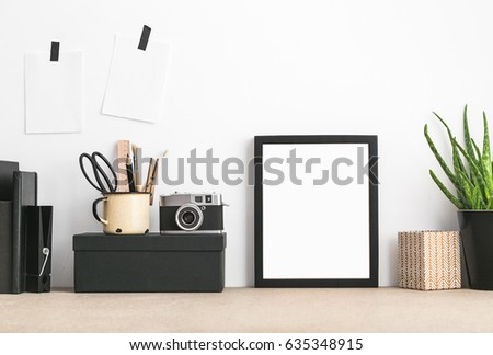 Black Empty Frame, Plant, Camera And Office Supplies. Hipster Interior  Design.