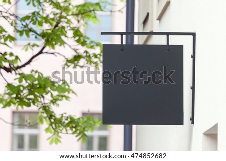 Black empty outdoor signage mock-up to add company logo