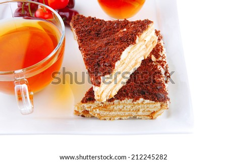 black english tea and cakes with red cherry - stock photo