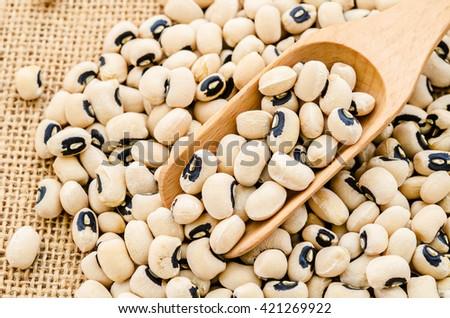 black eye beans on sack background. - stock photo