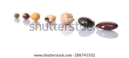 Black eye peas, mung bean, adzuki beans, soy beans, black beans and red kidney beans on white background. Frontal selective focus on subjects. - stock photo