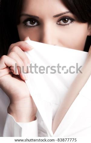 black eyes woman face behind perfect white sleeve, close up, studio shot - stock photo
