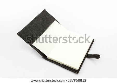 Black fabric case book on white background.  - stock photo
