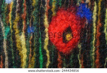 Black fabric texture of wool with red poppy,  Craft background - stock photo
