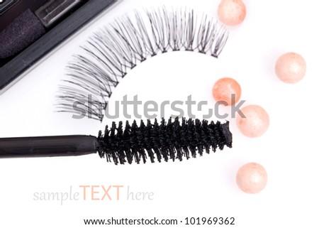 black false eyelashes with mascara and powder, on white background - stock photo