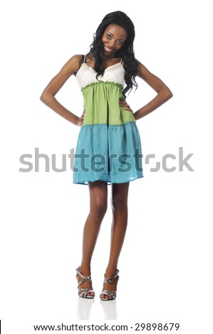 Black fashion model posing wearing a dress and isolated on a white background